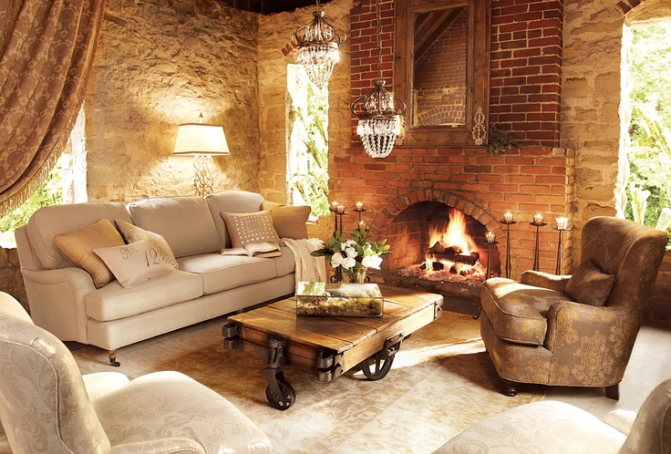 LOVE the walls! - very tuscan looking. And I love the fireplace: I want a fireplace in every room of my house.