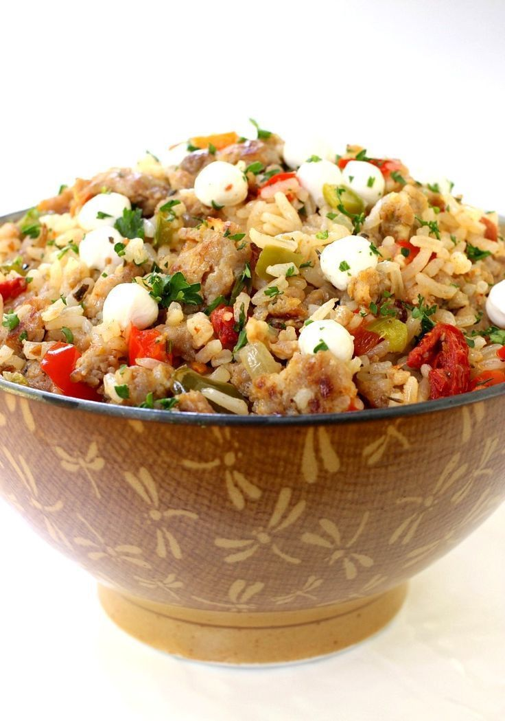 This Italian Fried Rice is a fun twist on the traditional fried rice. Full of sausage, peppers and mozzarella cheese!