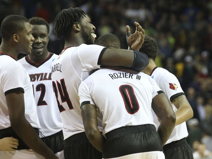 U of L's Montrezl Harrell, #24, embraced teammate Terry Rozier, #0, right, after he forced UC Irvine's Alex Young, #1, to turnover the ball in the closing seconds of U of L's win at the KeyArena in Seattle | Louisville vs. UC Irvine basketball