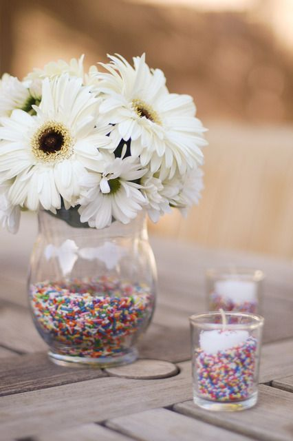Host a Sprinkles and Funfetti birthday party jam-packed with confetti, sprinkles, and fun. We love this idea for a sprinkles centerpiece. Cute!