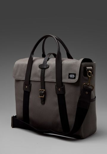Grey bag with leather black straps