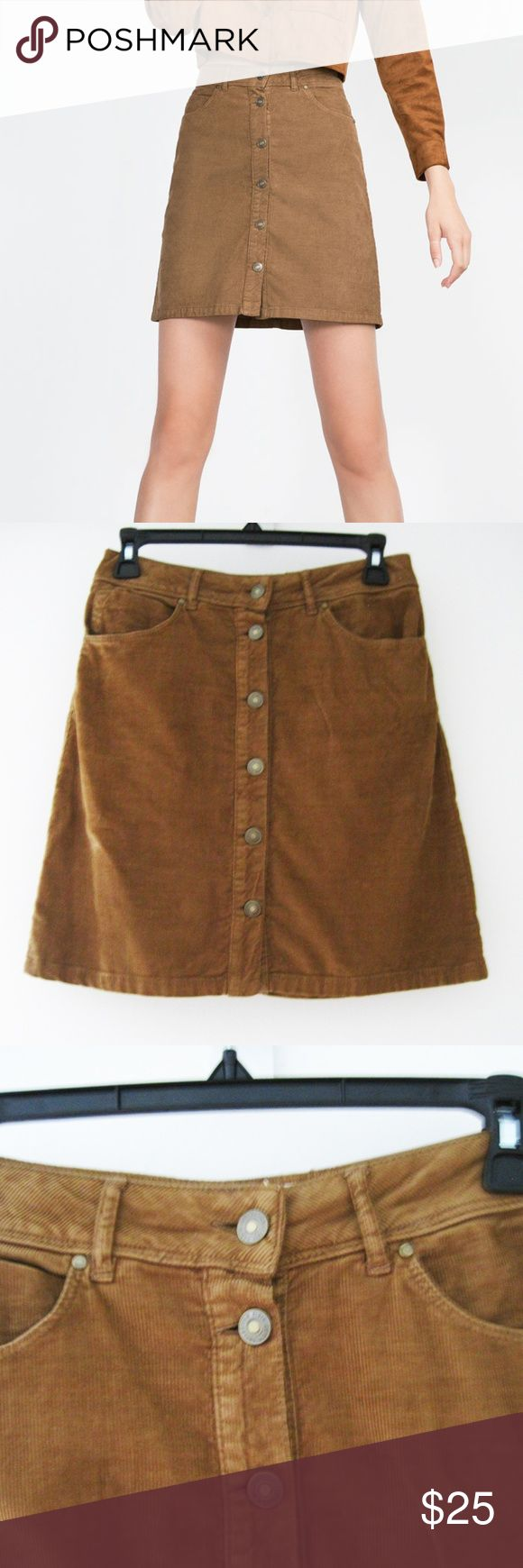 """Zara Brown Corduroy Button-Up Skirt XS Brown corduroy button-up skirt with front and back pockets. Excellent condition-worn 2x. Smoke/pet-free home. Feel free to ask questions. All images are my own except for the 1st and last 2 photos. Credited to Zara online image. Measurements: Length: 18"""" Waist: 28"""" Hip: 33"""" Zara Skirts Mini"""