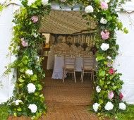 Wedding marquee entrance with flower arch of Hydrangea. love it!!