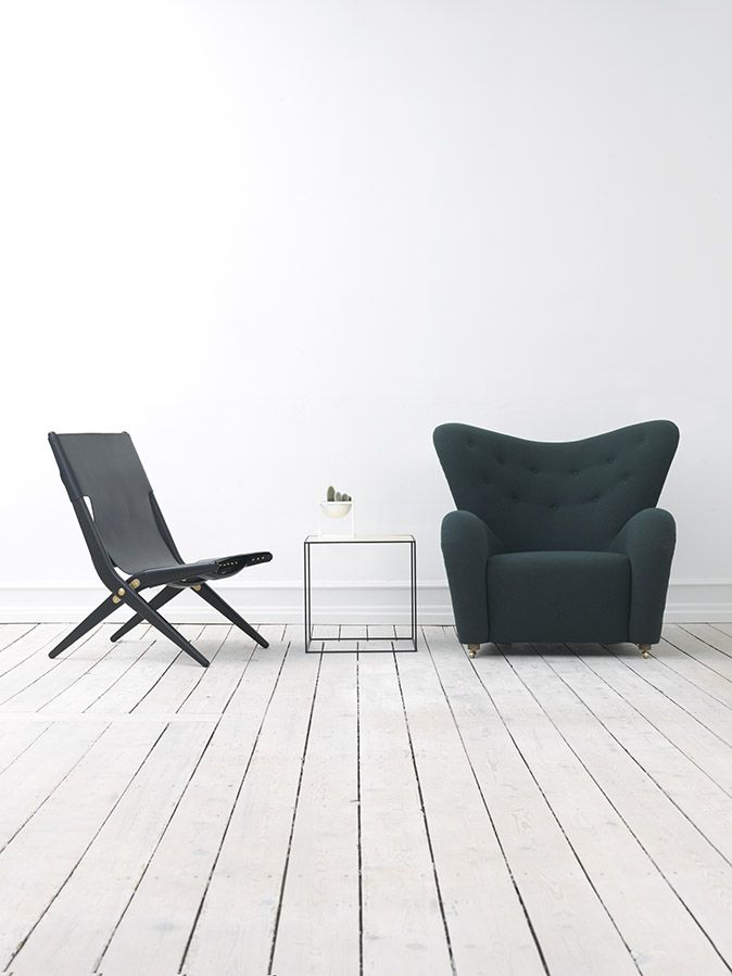 The Tired Mand (Den Trætte Mand) was designed by architect Flemming Lassen in 1935 and is launched by by Lassen in 2015. Comes in wool and lambskin. Saxe was designed by Mogens Lassen in 1955 and the Twin table in brass/misty green is a new by Lassen product.