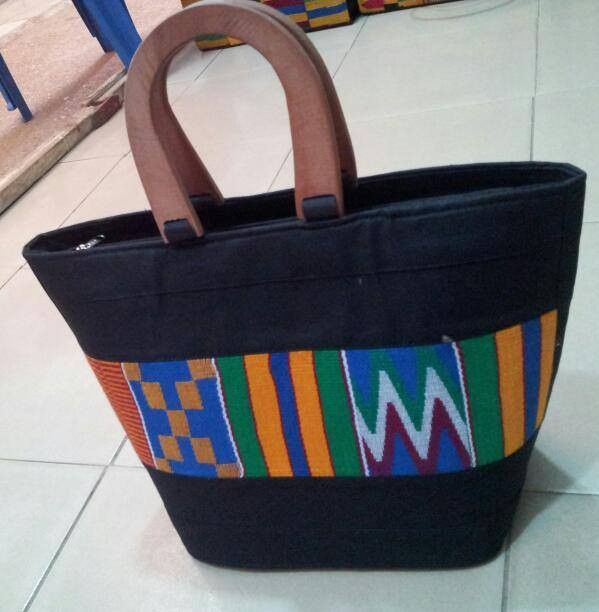 Black Kente Carrying Bag Be bold and vibrant with this ethnic kente print…