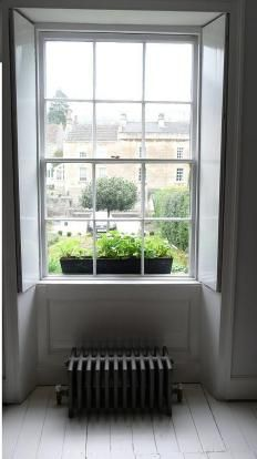 Old school. Sash windows and radiators.. Love old stlye radiators,and window shutters..reclaimation yard?