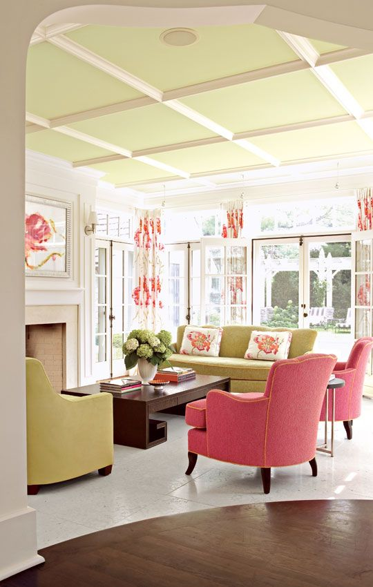 Brightly painted coffered ceiling// This family room's six sets of French doors create an airy California look, and the coffered ceiling suggests the architectural style of the home's original construction - Traditional Home®