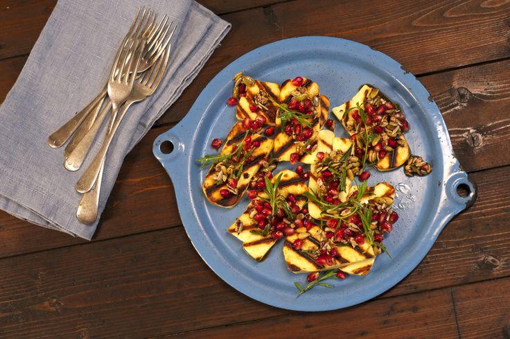 Grilled haloumi salad w pomegranate, za'atar and sumac dressing