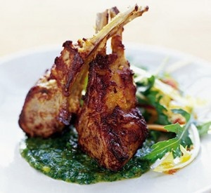 Grilled lamb chops with a sun dried tomato and olive gratin