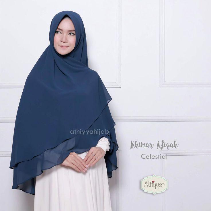 Athiyyah Hijab Khimar Afiqah Calestial - hijab khimar jilbab kerudung pashmina syari Untukmu yg cantik syari dan trendy . . - khimar instan - pet kokoh dan lentur - pet anti tembem (antem) - dari bahan babydoll original GRADE A bahan bertekstur pasir bahan ini juga digunakan salah satu brand terkenal jadi kualitas bahannya tidak diragukan :) kecuali warna iris bahannya lebih kasar dibanding yang lain - jahitan halus dan rapih - keliling bagian bawah dijahit bukan dineci jadi lebih bagus dan…