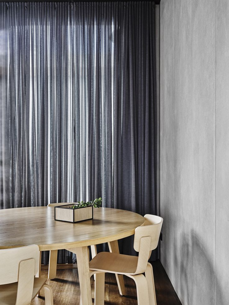 Rob Kennon Architects   Burnley House light wood dining furniture long grey curtains