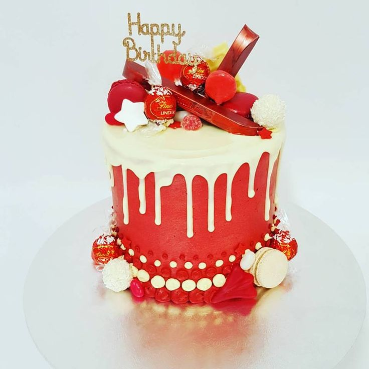 Tall red overload with white chocolate drip and red toppings
