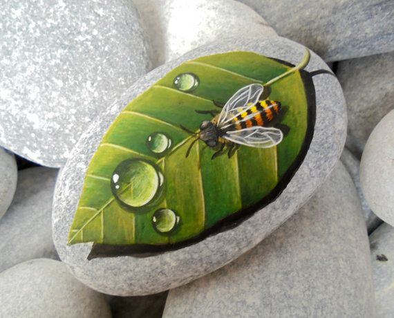 Hand Painted Stone Bee On A Leaf Is Painted by KanetisStones