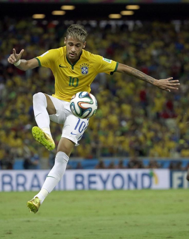 Brazil's Neymar controls the ball during the World Cup quarterfinal soccer match between Brazil and Colombia at the Arena Castelao in Fortaleza, Brazil, Friday, July 4, 2014. (AP Photo/Hassan Ammar)