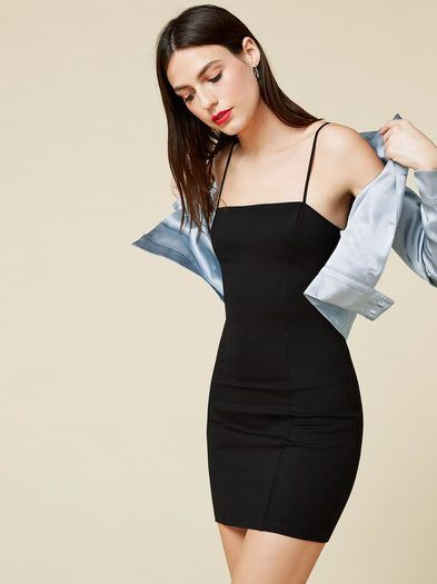 The 90s called - they want their dress back. This is a micro-mini, tight fitting dress with a straight neck and center back zipper.
