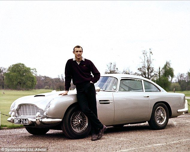 The Aston Martin DB5 first appeared in the Bond franchise in the 1964 film Goldeneye starring Sean Connery, pictured next to the classic car, as the famous spy