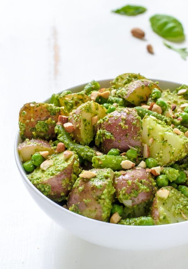 A bright and healthy pesto potato salad with green beans and peas. Every bite bursts with fresh summer flavor!