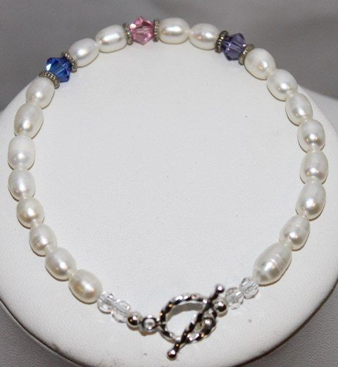 Blingz the Thing Store - Mom's pearl bracelet - She's always there to offer advice, guidance and a tender hug. Honor and celebrate Mom, a woman who continues to stand by your side through thick and thin. A gift filled with love, Sure to brighten her day, this handcrafted fresh water pearl and Swarovski crystal  sterling silver bracelet will place a sweet smile on her face each time she glances at it.