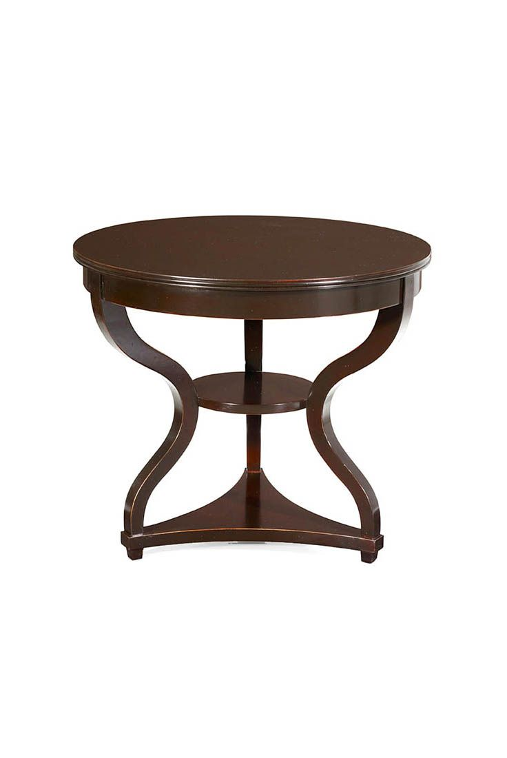 The Morumbi occasional table is shown in Cherry wood with an Ebonised Wood finish. Note the unique shape of the piece, and the light, rounded legs. It has a small, central shelf and a flat base at foot-height.