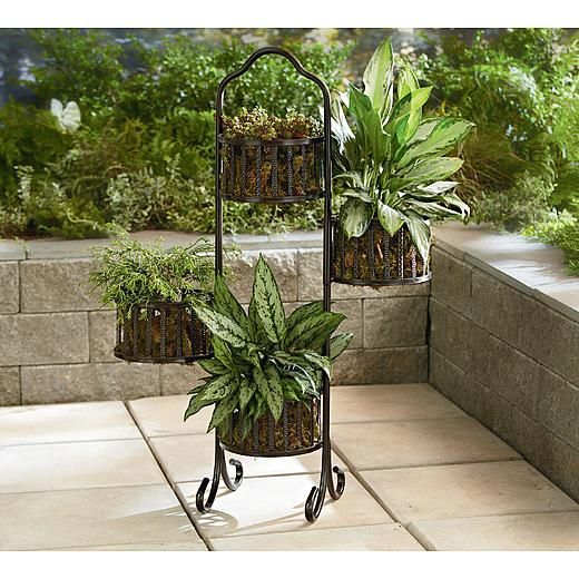 Swinging Plant Stand KMart free ship to store. sale 29.97 all 4 sections swivel so you can configure this plant stand to fit your needs.
