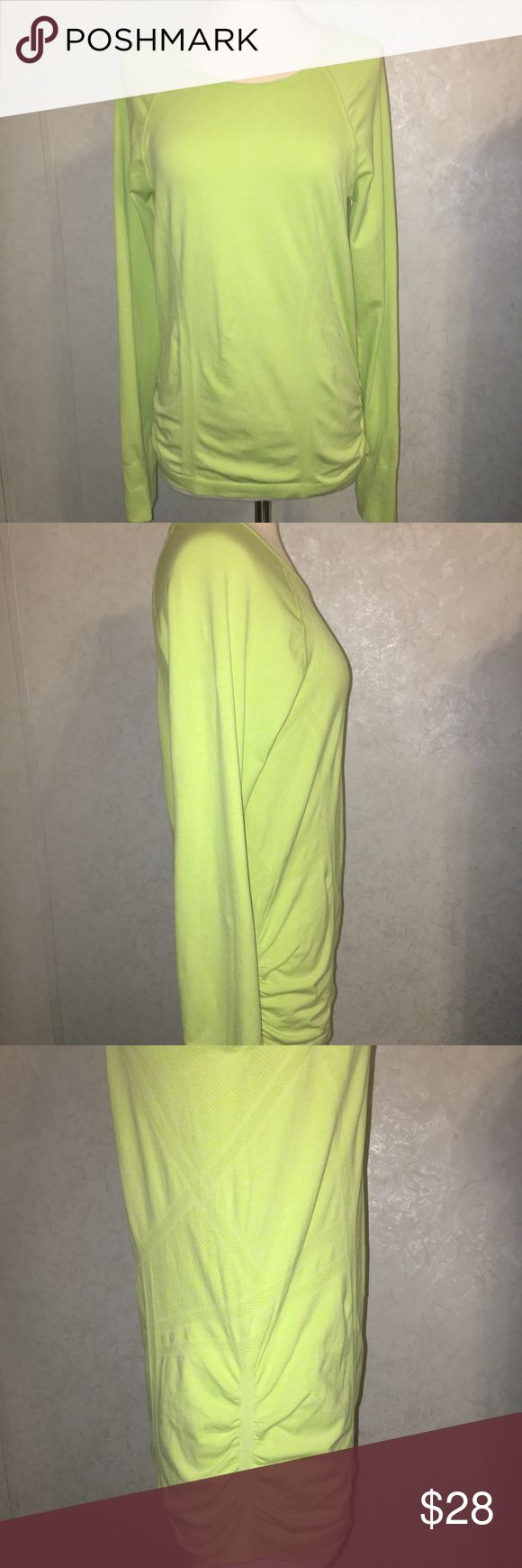"Athleta Neon Running Top - Large Athleta Neon Running Top - Large Thumb holes - great neon color Gently loved - ready for new home Ruched sides - 17"" Pit to Pit 16"" Pit to Bottom  15"" Shoulder to Bottom - 30"" Sleeve 17"" Across Bottom All measurements taken laying flat are approximate  Pet Free-Smoke Free Home  Thanks for looking! Athleta Tops Tees - Long Sleeve"