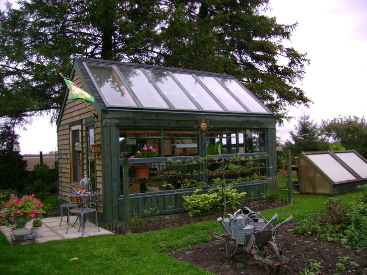 grow food all year long recycled patio door greenhouse project good ideas cinder block floor over hardware cloth prevents rodents digging in and under - Garden Sheds With Greenhouse