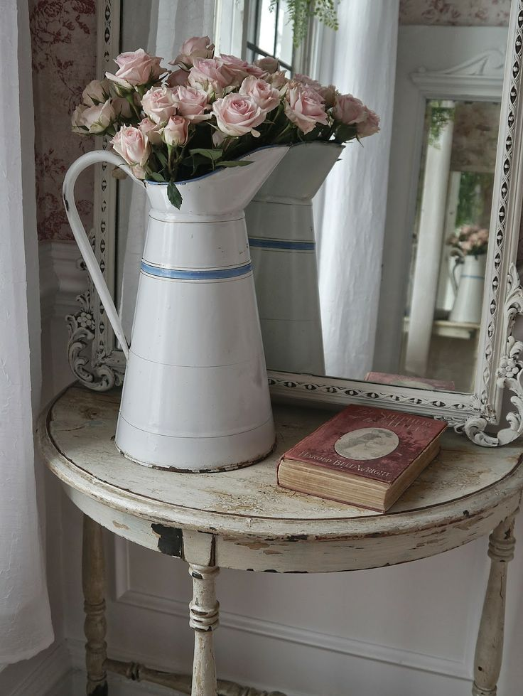 Chateau Chic: half moon table, enamel pitcher, antique mirror