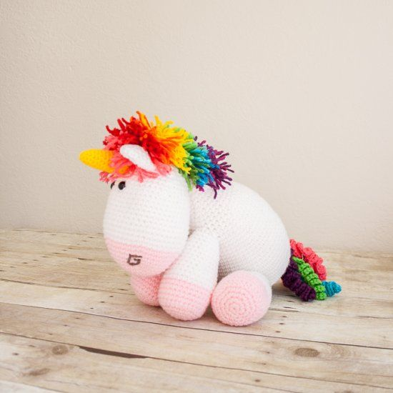 Add a bit of color to your life with a fun and cuddly unicorn. Free crochet pattern.