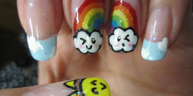 A Rainbow Pop Of HappinessWith a nail art marker, dotting tool, and easy to find polishes, I painted a 'kawaii' (cute) rainbow and sun that is sure to bring a smile to everyone's face.