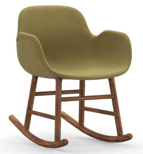 This upholstered rocking chair combines the aesthetics of an armchair, alongside a side chair and a rocking chair