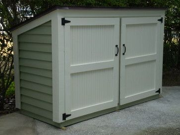 Small shed for lawn mower and gardening tools. Wonder if I could make one of these?