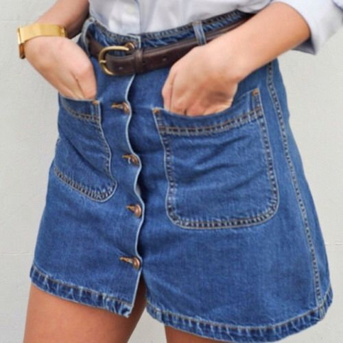 Super cute and on trend bottom down denim skirt. Style it with some old-school trainer and a loose t-shirt tucked in. Find a similar one here: http://asos.do/rByD4Q