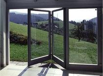 baie vitrée pliante-coulissante en bois-aluminium  KAPO