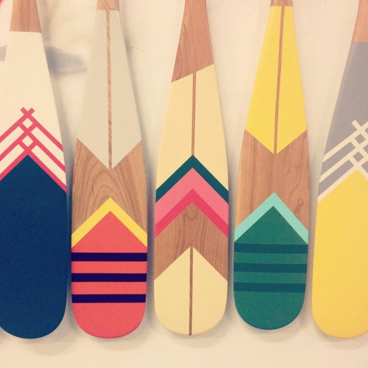 These hand painted row boat paddles add color to the nursery! Follow Bitzy Baby for more natural nursery ideas! #bitzybaby