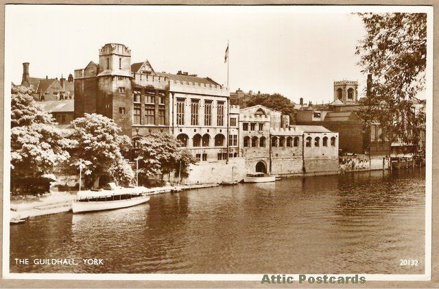 Vintage real photo postcard of The Guildhall in York, Yorkshire, England.  Depicts the hall and moored boats.
