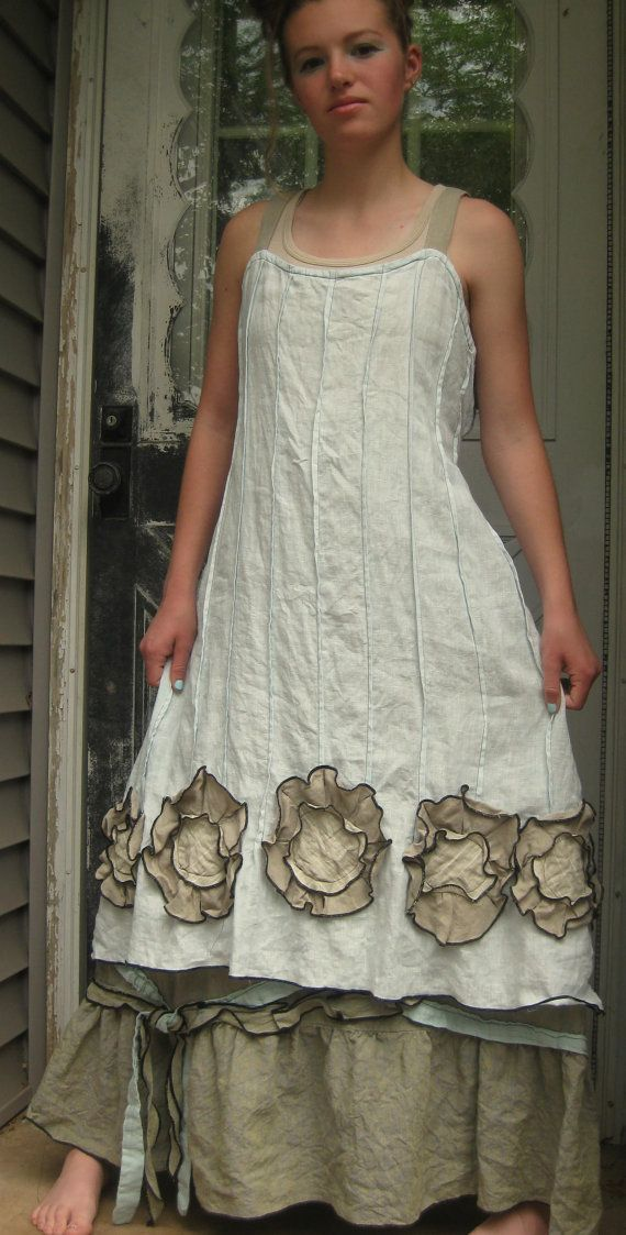 Light blue lightweight linen in a Flower Bottom Dress. this has an aline shape with pintucks all around, side ties for fit, and flowers in tan and stripe. Very fun! I love this dress! Plus size bust 50, length 41.