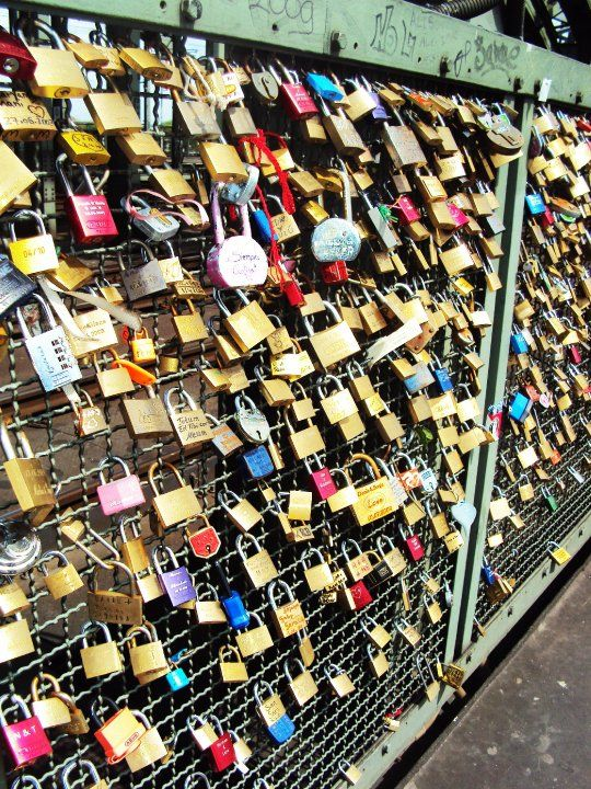 Bridge over Rhein River in Germany...people started to put love locks with their dates, names on the bridge fence...getting bigger by the minute.