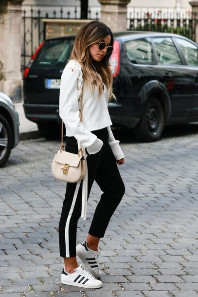 $60 Black And White Striped Standard Adidas Superstar Sneakers Teamed With Black Sportswear Pants With A White Side Stripe Detail And White Long Sleeved Sweater Workout Inspired Outfit Tumblr