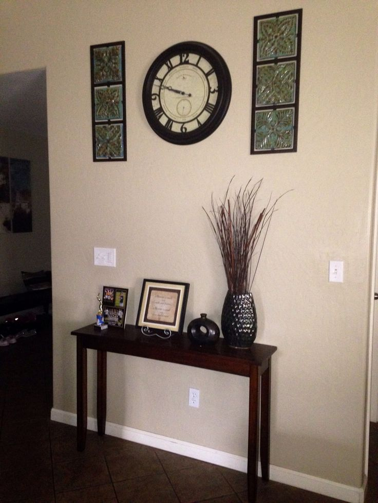 Narrow entryway table wall clock with wall decorations for Foyer decorating ideas small space