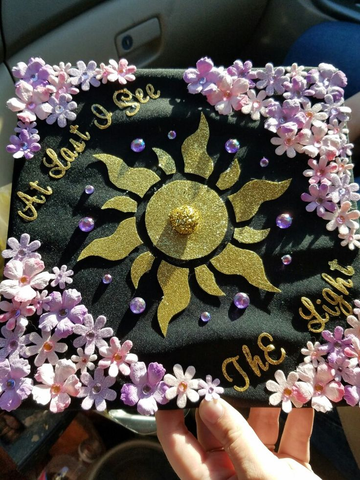 My daughter decorated her graduation cap with a tangled theme. I think it's beautiful!