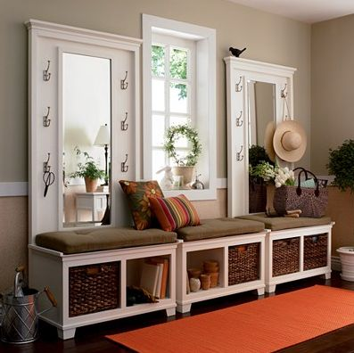 incredible mudroom. love all the hooks, the mirrors, and the compartments under the bench