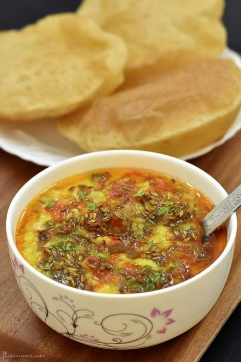 Traditionally served with pooris, moong dal tadka is a super-delicious recipe. It has a garnish of onions, generous sprinkle of spices, & a cumin tempering.