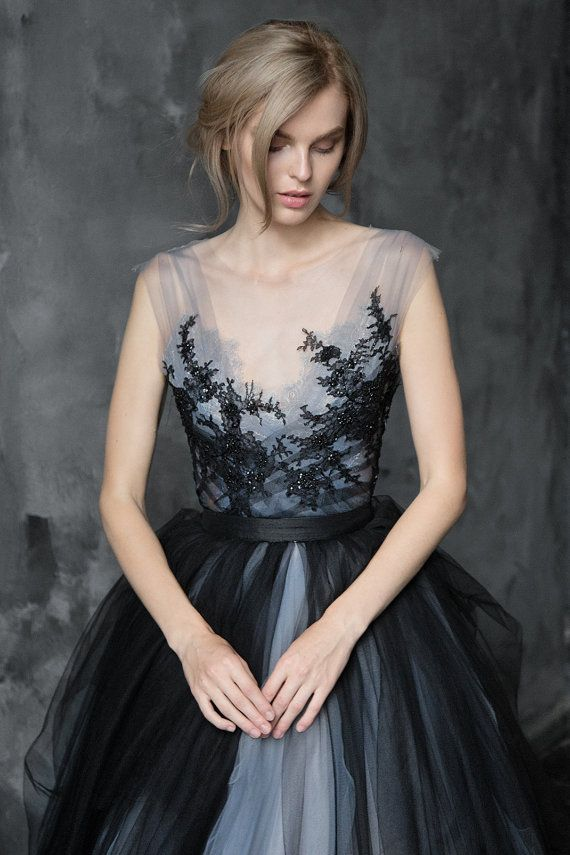 Calypso Nightfall is the most mysterious and magical gown from the Collection 2017 This ethereal wedding gown features a separate sleeveless top and the dramatic volumetric tulle skirt with long train. The top is made of multiple tulle layers draped under the beaded lace embroidery. The illusion mesh neckline gives almost bare look with ornately hand-sewn floral pattern lace going up to shoulders. It closes with side invisible zipper.  The skirt is multicolored, it consists of lavender grey…
