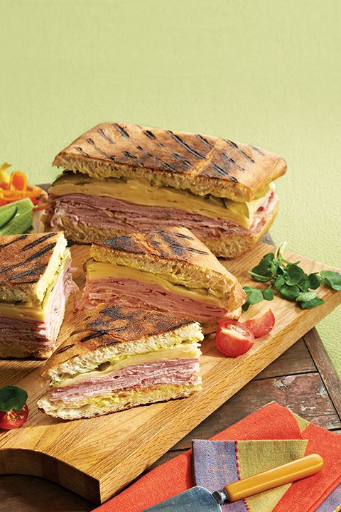 INGREDIENTS BY SAPUTO | In search of weeknight meal ideas? Your family will love this gourmet hot Cuban grilled cheese sandwich recipe with pork and ham. Add pickles and Armstrong sliced cheese for empty plates all 'round!