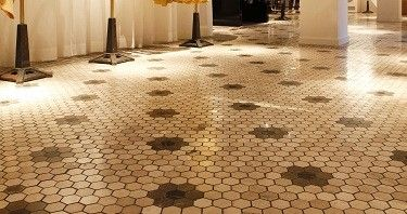 Mosaik designed by Designtegels.nl for the Scotch and Soda stores: honey comb with patern borders. Would be great for our upstairs bathroom!