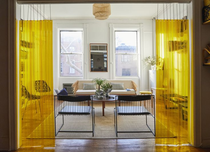 Yoga mat To divide the rooms, Valentin came up with an unconventional solution: yellow strip curtains, the kind typically used in industrial food storage facilities, suspended from a hospital drop chain sourced from a medical supply website.