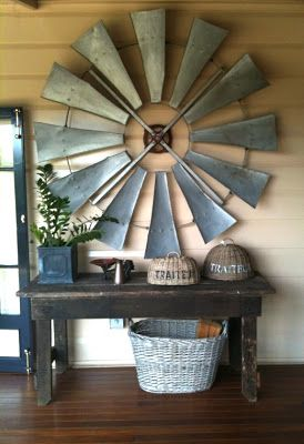 Absolutely love the wind mill on the wall!  Saw Joanna Gaines use only half of a large one on Fixer Upper.