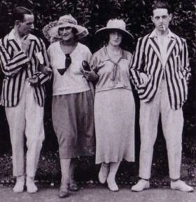 Like women, men loosened the constraints of previous decades and began to acquire a more relaxed, flashier wardrobe. The crease left the pant legs and the tie was abandoned. Colorful suits and patterned socks accented the wardrobe of the casually dressed.    The men in the images below sport the casual, laid back look that swept men's fashion during the 1920s.
