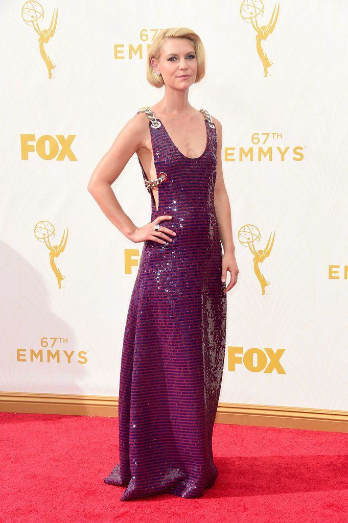 Pretty in purple! Claire Danes rocked a plunging sparkly Prada gown which featured huge gold chains on the red carpet at the 67th Annual Primetime Emmy Awards on Sept. 20, 2015 in Los Angeles, California.