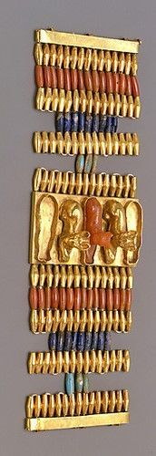 Golden cuff bracelet decorated with cats This bracelet is made from gold, carnelian, lapis lazuli and turquoise glass. In the middle three cats are shown. These cats are linked with the feline goddess Bastet, protector of the household. Egyptian. New Kingdom. 18th dynasty, reign of Thutmosis III, 1479 - 1425 B.C